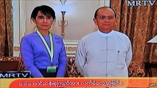 Grab from state-run MRTV shows Aung san Suu Kyi with Burmese President Thein Sein on 19 August 2011