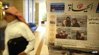 Man walks past newspaper stand in Saudi Arabia