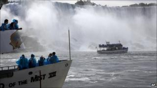 Tourist boats and the Maid of the Mist passenger ship in Niagara Falls, Ontario