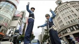 Police stop traffic as part of the drill in Ginza, Tokyo, on 1 September 2011