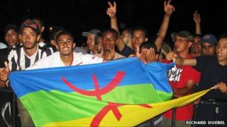 People holding the Berber flag during the annual Timitar festival in southern Morocco earlier this year (Photo taken by Richard Duebel)