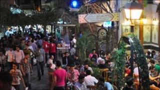 People out on the street in Damascus celebrating Eid