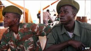 Former Sudanese militia fighters attend a ceremony in the town of Damazin, in Blue Nile province, 2009