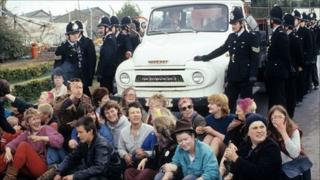 Women blocking a police van at Greenham Common in 1983