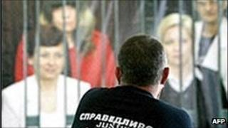 A Bulgarian man looks at a poster supporting the release of the medics