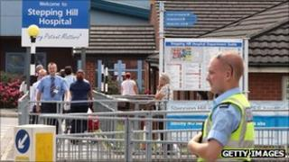 Security guard outside Stepping Hill Hospital in July