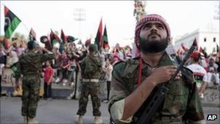 A rebel fighter in Martyrs' Square in Tripoli, Libya, Sept 2