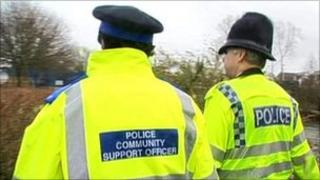A community support officer and police officer
