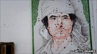 Bullet-ridden mosaic of Col Gaddafi on a wall in Tripoli on 29 August 2011