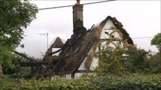 Thatched cottage in Sutton after fire
