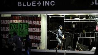 Man entering shop window
