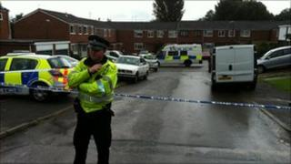 A police officer outside the house in Thame