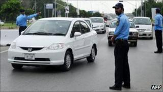 Policemen at a checkpoint in Islamabad in August 2011