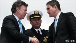 Colombian President Juan Manuel Santos shakes hands with new defence minister Juan Carlos Pinzon