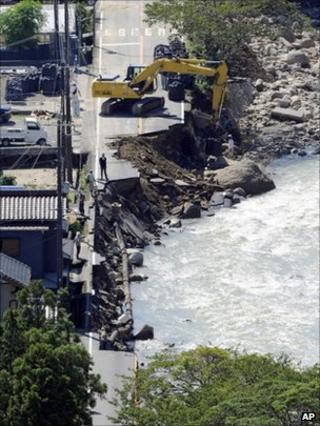 Road washed away by flood water in Nachikatsuura, Wakayama Prefecture, central Japan