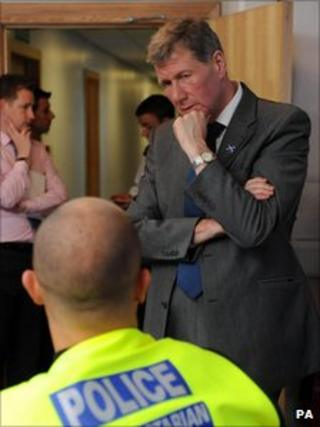 Kenny MacAskill MSP speaks to a policeman