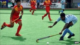 India's Kullu Nanjeet (R) battles for the ball against China (in red) during their match for the first Asian Men's Hockey Championship in Ordos, Inner Mongolia, on September 3, 2011.