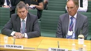 Former News of the World editor Colin Myler and lawyer Tom Crone are giving evidence to MPs