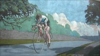 A mural in Morley showing Beryl Burton in action