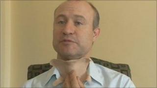 John Pickup demonstrates the prosthetic throat