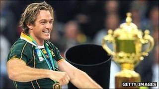 South Africa's Percy Montgomery walks next to the William Webb Ellis cup after winning the 2007 final against England