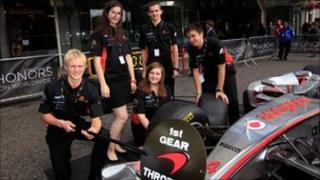 The Dynamic team with a Formula One McLaren car