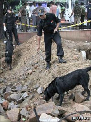A sniffer dog at the blast site outside the high court in Delhi