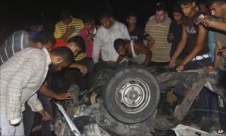 Wreckage of a car that killed an Islamic Jihad militant in Deir al-Balah, central Gaza Strip, 7 September