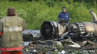 A policeman stands at the site of a plane crash outside Petrozavodsk