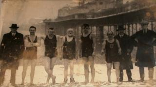 Swimmers standing in front of Palace Pier in 1929