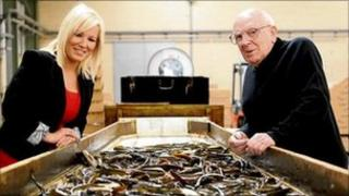 Agriculture Minister Michelle O'Neill and Fr Oliver Kennedy at the eel fishermen's cooperative
