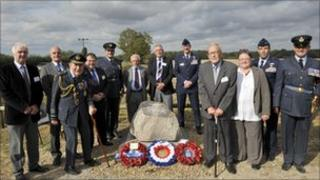 People stand by Narborough Aerodrome memorial