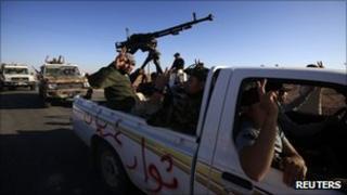 Rebel vehicles drive towards Bani Walid, 10 September 2011