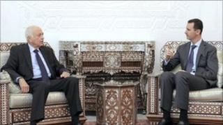 Syrian President Bashar Assad, right, meets with Arab League Secretary General, Nabil al-Arabi, left, in Damascus, Syria, on Saturday Sept. 10, 2011.