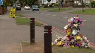 Flowers left at the scene of the collision in Lode Lane