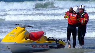 RNLI lifeguards taking part in a training exercise