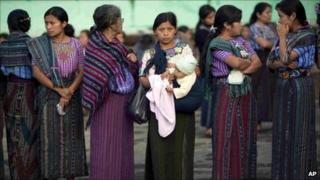 Women wait in a line to vote during the general elections in Santiago Atitlan, Guatemala, 11 September 2011