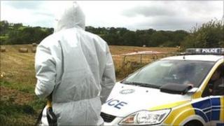 The bodies were found in a field near Ravernet