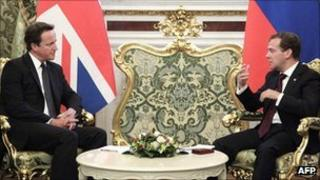 British Prime Minister David Cameron (left) and Russia's President Dmitry Medvedev talk during their meeting in Moscow