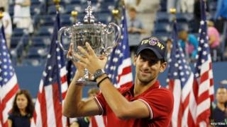 Novak Djokovic poses with his trophy after winning the US Open