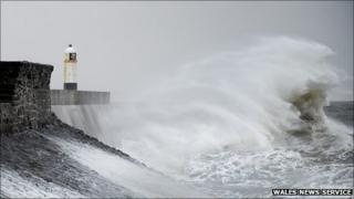Waves crashing at Porthcawl Lighthouse