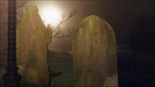 Headstones at night