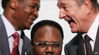 This file picture taken 16 February 2007 in Cannes shows French President Jacques Chirac (R) talking with President of Burkina Faso Blaise Compaore (L) behind Gabonese President Omar Bongo Ondimba