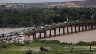 Cars cross a bridge in Niamey, Niger, Monday 12 September 2011