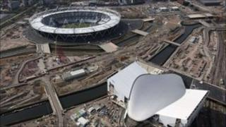 London's Olympic Stadium [top] and the Aquatics Centre