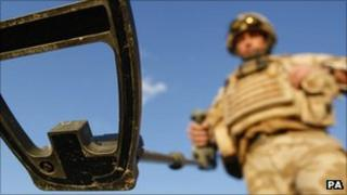 British soldier on a training exercise to detect IEDs in Camp Bastion in the Helmand province of Afghanistan