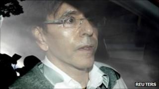 Belgian government broker Elio Di Rupo arrives in a car for talks in Brussels, 14 September