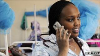 Doctor on a mobile phone at a hospital in a remote part of Kenya