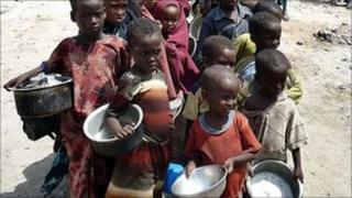 Children queue for food at a feeding centre in Mogadishu