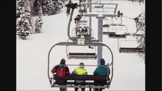 Skiers using a chair-lift